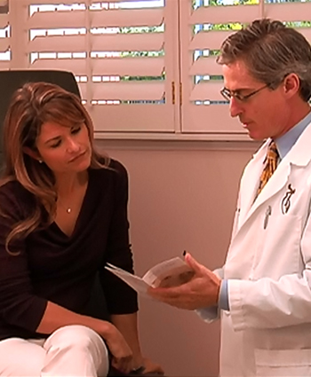 Dr. Rotatori caring for a patient in his Winter Park office.